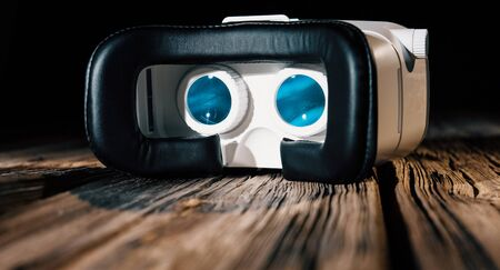 Virtual reality goggles, old wood planks