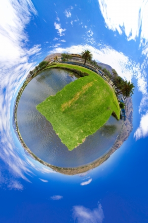 Little planet panorama of a lake photo