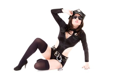 police girl: cute police woman sitting on a white background Stock Photo