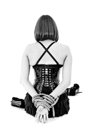 woman in corset with hands tied