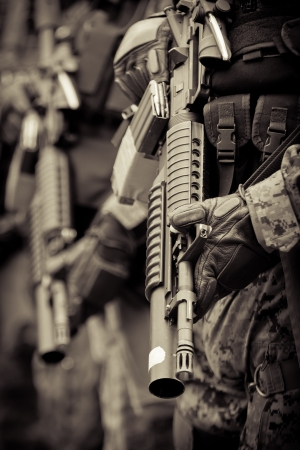 combat boots: soldier in formation with armo assault rifle
