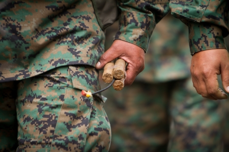 soldier holding  dynamite with fuse Stock Photo - 15508720