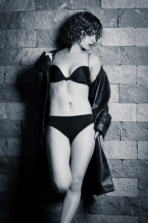 young beautiful woman in underwear and a raincoat photo