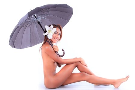 Beautiful naked body of young woman with umbrella  Stock Photo