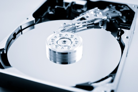 an opened hard disk, color processed, studio shot photo