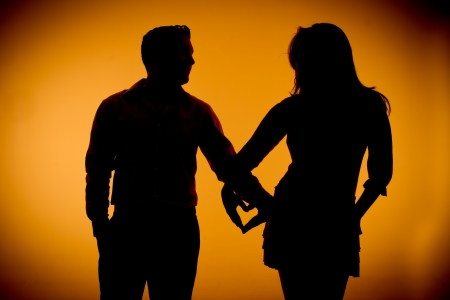 couple silouette photography holding hands