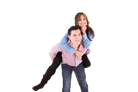 Happy smiling couple piggyback together  photo