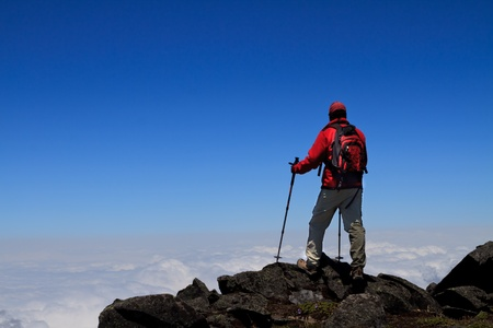 Man on peak of mountain   photo