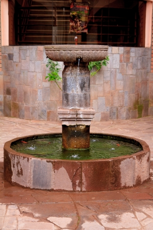 Old Inca style Water fountain in Peru photo