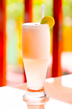 Pisco Sour on a tall glass photo