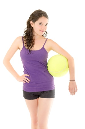 woman  poses with a big tennis  ball photo