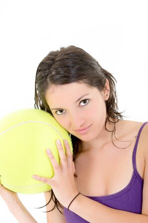 young adult woman with big  tennis ball photo