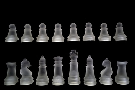 Chess set isolated on black photo