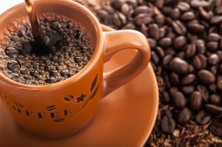 coffee pot: Coffee cup with fresh coffee beans