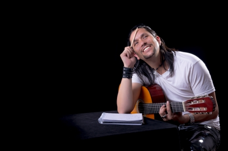 Guitarist musician writing a song on his guitar Stock Photo - 18909577