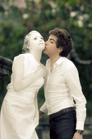 Young male KISSING at a female MODEL statue photo