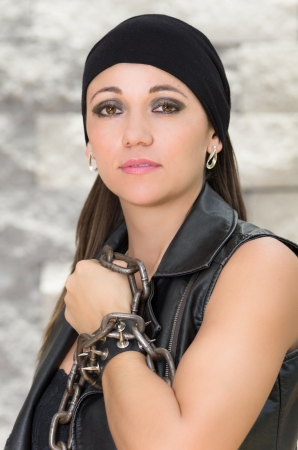 attractive brunette in black, gang member photo