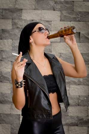 Woman having a beer drink and a smoke  photo