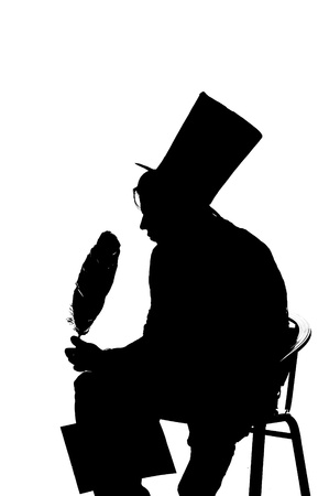 silhouette man sitting on a stool while writing photo