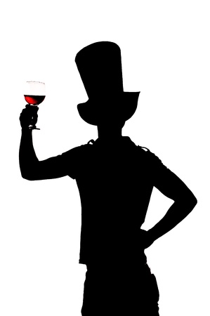 silhouette of a man with a glass of red wine photo