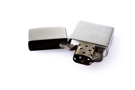 Silver metal zippo lighter isolated on white photo