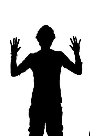 mugging: silhouette of a man being robbed with hands up