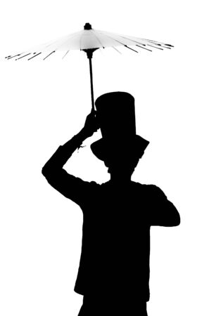 Silhouette of a man in a hat with an umbrella   photo