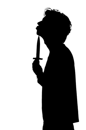 cut wrist: silhouette of a man attempting suicide knife