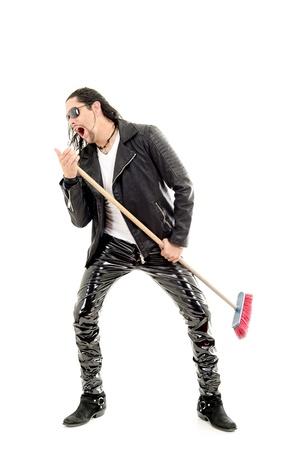 kareoke: Man Rocking Out with broom Stock Photo