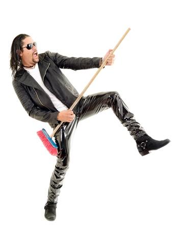 air guitariste passionné joue sur fond blanc Banque d'images