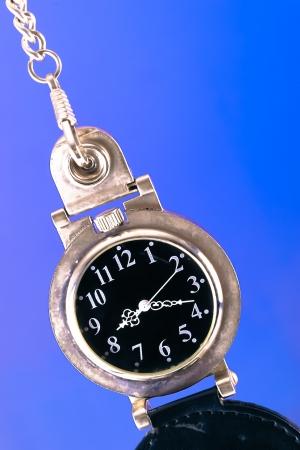Old pocket watch on pop background photo