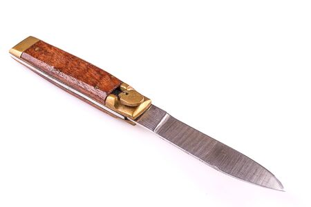 outlaws: pocket knife with wood handle isolated over white