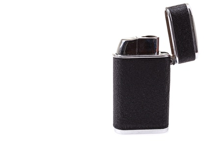 Metal lighter on white background, Black color photo