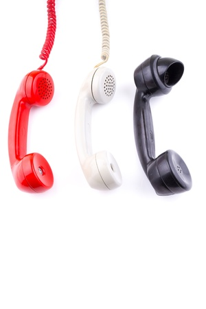 emergency number: Hanging rotary telephone hand sets