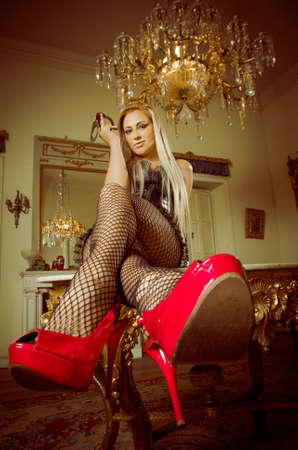 blonde lying on a table with heels and stockings photo