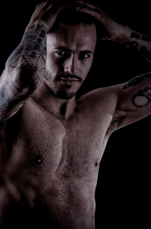 Muscular young man with many tattoos, dragan style