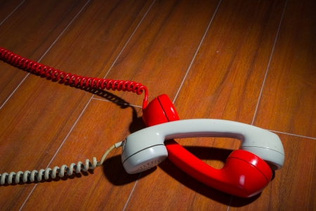 Old vintage phone handsets on wood photo