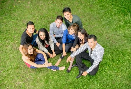 Group of hispanic teens thumbing up outdoors photo