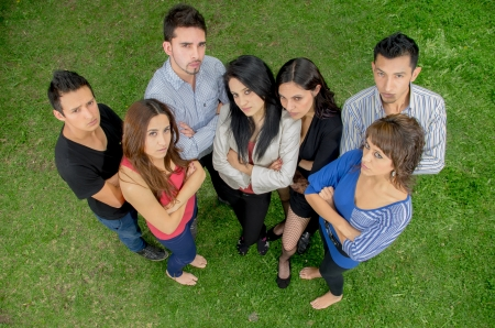 businessteamwork: Group of serious hispanic young people