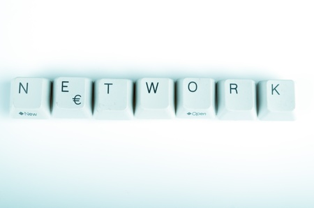 Network word written with computer buttons photo