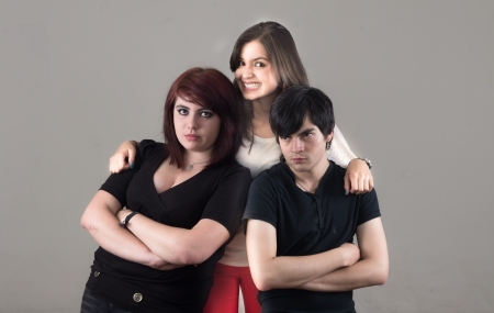dark metal couple with happy colorful girl in the middle photo