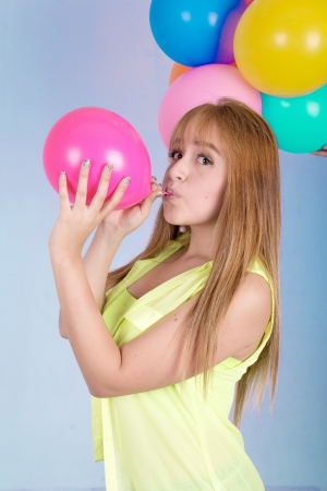 happy cute woman with balloons photo