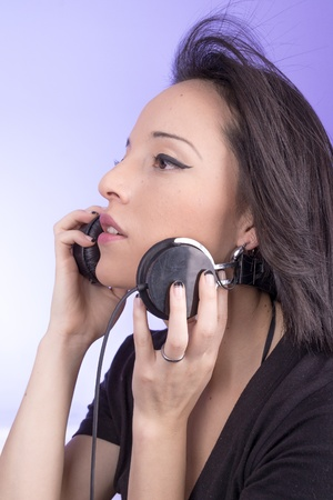 18 19: portrait of woman with headphones music