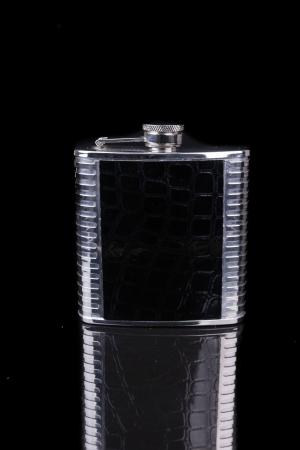 hip flask: Hip flask on black background