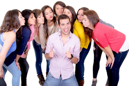 lascivious: eight young women kissing  handsome man standing between them - isolated on white