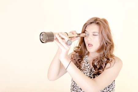 Young woman using telescope photo