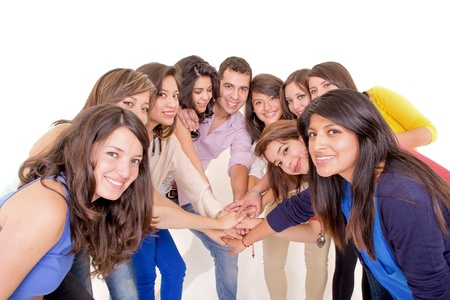 Teamwork  Group of young and diverse people joining hands Banco de Imagens