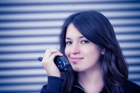 btp: Businesswoman in warehouse using walkie-talkie