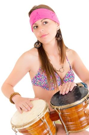 bongos: beautiful woman playing bongos studio shot