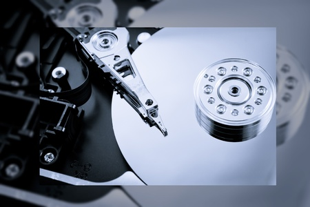 metaphorical: Information technologies background with hard drive Stock Photo